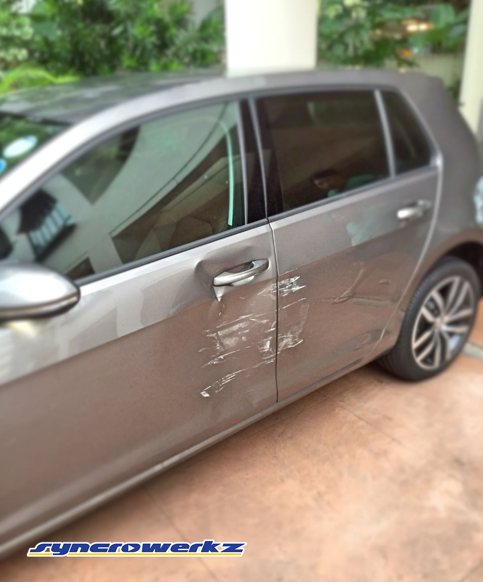 Volkswagen Golf Mk7 with epic door damage